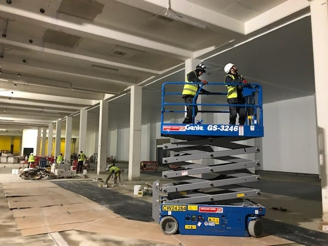 High Level Ceiling Cleaning with Scissor Lift By Hand